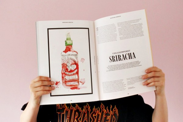 Boy holding magazine, covering his face. Printing Friends Magazine with Sriracha