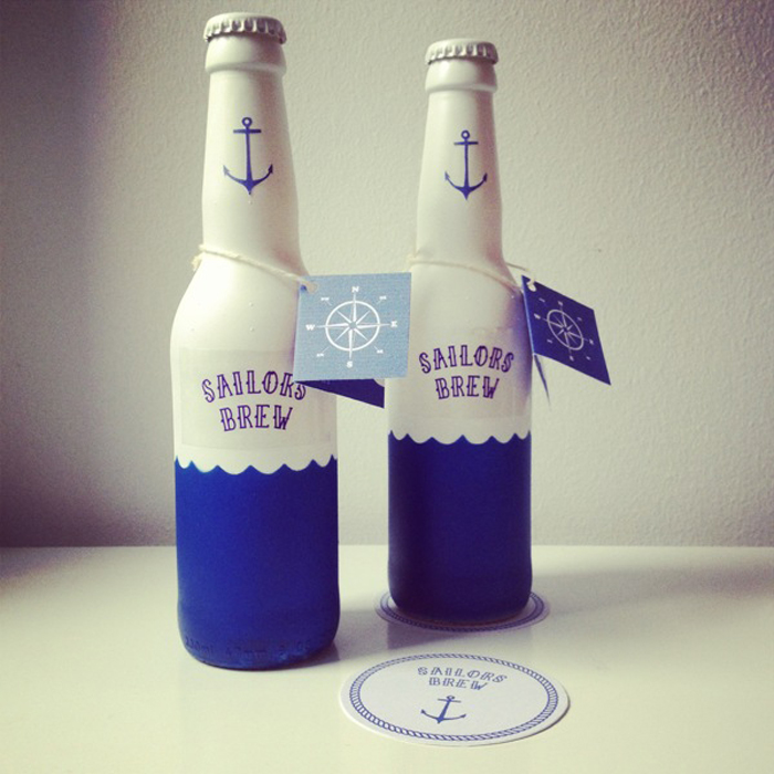 Beer Bottle Designs, sailor brew in white and blue beer bottles.