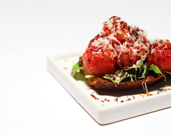 Tomato Bruschetta with dried olives and Parmesan cheese