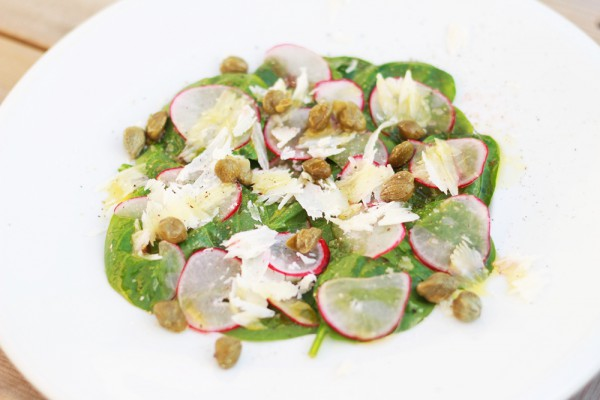Spinach salad with capers, Parmesan cheese and radishes