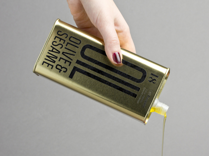 Olive oil packaging in golden metal
