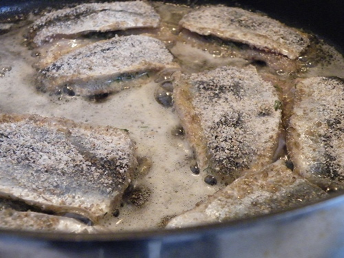 Herring being fried, this herring will later be pickled.