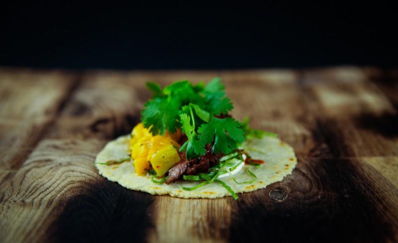 Beef taco with mango salsa and cilantro 1