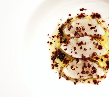 Burnt cod with grated Kalamata olives