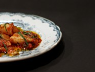 Braised calamari with tomatoes, chili and garlic