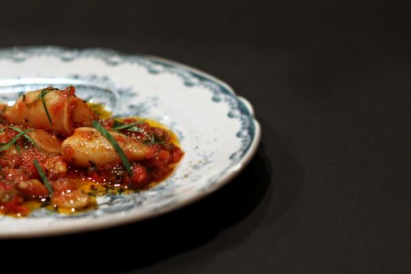 Braised calamari with tomatoes, chili and garlic
