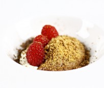 Chocolate mousse with white chocolate crumble and raspberries