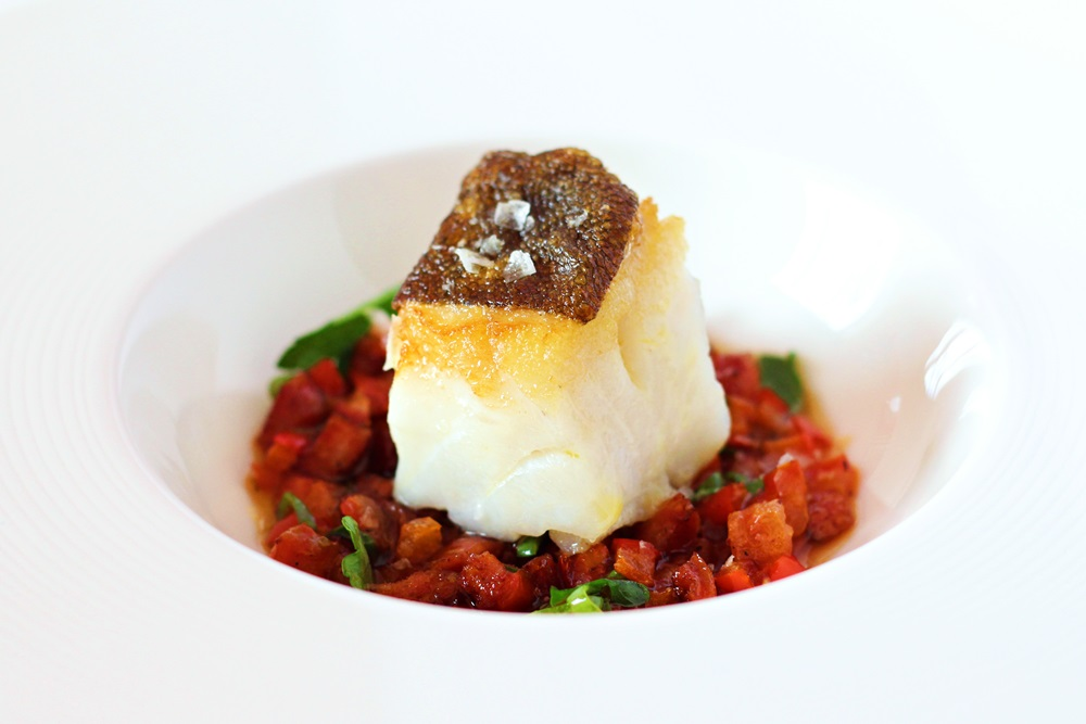 Seared cod with Italian Salsiccia and Tomatoes