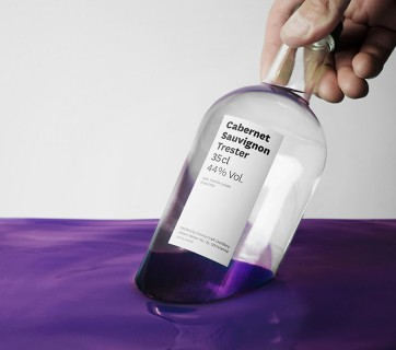Bottles dipped in Paint for the Edelbrand Series Packaging