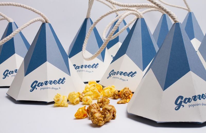 This cool cone popcorn packaging design was made as a student project for The Garrett Popcorn shops in Chicago