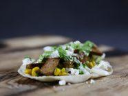 Pork Collar Taco with Chipotle Corn Salsa, Cilantro Sauce and Feta Cheese