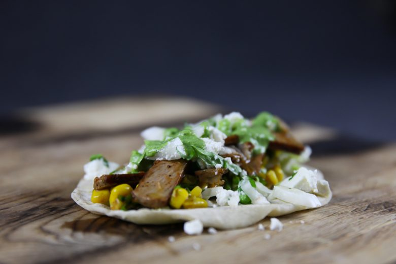 Pork Collar Taco with Chipotle Corn Salsa, Cilantro Sauce and Feta Cheese